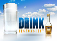 Water and Alcohol. A big glass of water, a small alcohol bottle and the text drink responsibly Stock Image