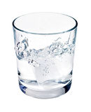 Water or alcohol splashing from ice cube Royalty Free Stock Images