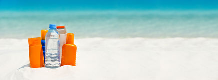 Water And Sun Protection Cream On The Beach Royalty Free Stock Images