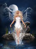 Water Angel. A beautiful water angel on the sea! Candles on a rock to light the surrounding area Royalty Free Stock Images