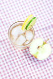 Water and,apple in a glass with ice Stock Images