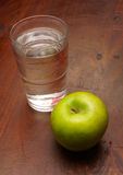 Water and a apple Stock Image
