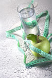 Water and apple Stock Photos