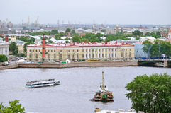 Water area of Neva river and historic bulding of southern warehouse with rostral column  in the center in Saint Petersburg, Russ Stock Image