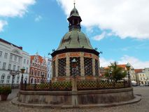 Water art, Wismar, Germany, 2014. The water art on the main square of Wismar. It is a landmark of the Hanseatic city. The building was used by the 16th until the Royalty Free Stock Images