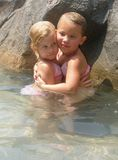 Water Babies. Sisters enjoy their day together at the pool Royalty Free Stock Image