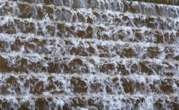 Water Background. Water running over stone steps Stock Image