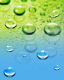 Water background. Drawing of waterdrop in a colourful background royalty free stock images