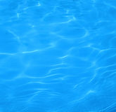 Water background. Reflections in a swimming pool Stock Images