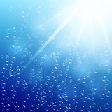 Water background with air bubbles and sunlight Royalty Free Stock Images