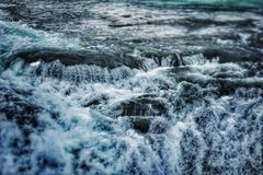 Water background. Water flowing in a waterfall in iceland Royalty Free Stock Photos