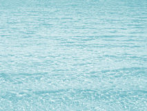 Water background. Light turquoise or light blue colored. Royalty Free Stock Photography