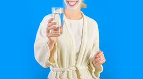Water balance. Woman bathrobe hold glass of water. Morning habit to drink water. Health care concept. Stay hydrated. Health and beauty. Spa and wellness. Girl royalty free stock image