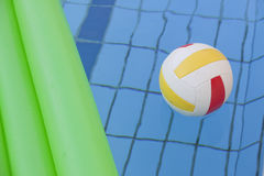 Water ball and air mattress in pool Royalty Free Stock Image