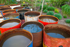 Water barrel. Old rusty water barrel in a garden Stock Image