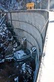 Water Barrier Dam By Frozen Lake Stock Photo