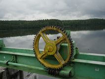 Water barrier lifting mechanism. With toothed wheels stock images