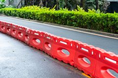 Water barrier on the road in town. Partition stock photography