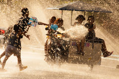 Water Battle during Songkran Festival in Chanthaburi, Thailand. The horizontal image of people enjoying water splashing to each other in the water tunnel during stock images