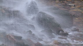 Water beating on the rocks.. stock footage
