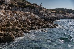 The water beats on the rocks of the coast in Greece. 2018 stock photo