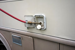 Water being fed into a motorhome Royalty Free Stock Photo