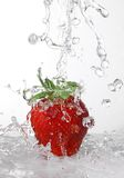 Water being poured in a strawberry Stock Images