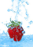 Water being poured in a strawberry isolated Royalty Free Stock Photo