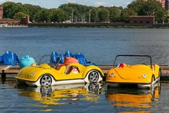 KALININGRAD, RUSSIA - AUGUST 24, 2017: Parking of water bicycles on the Upper Lake in the center of Kaliningrad. Water bicycles are a popular tourist attraction royalty free stock image