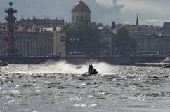 Water bike rushes through the waves Neva Royalty Free Stock Photos