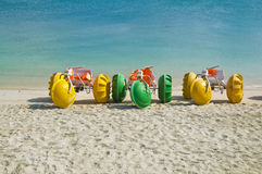 Water bikes. Colorful water bikes parked on the beach Royalty Free Stock Images