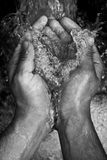 Water. Black and white picture of clear water catched with hands Royalty Free Stock Photos