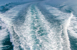 Water blue ocean splash and boat in the sea way background Royalty Free Stock Images