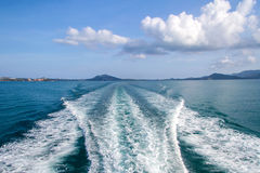 Water blue ocean splash and boat in the sea way background Stock Images