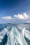Water blue ocean splash and boat in the sea way background Royalty Free Stock Photos