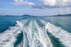 Water blue ocean splash and boat in the sea way background Stock Photo