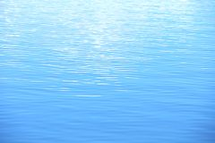 Water is a blue and the small ripples Royalty Free Stock Photography