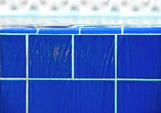 Water on blue tiles stock photo