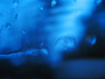 Water blur. Rain drops trickling across a moving car window Royalty Free Stock Image