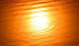 The water blurred reflection of the sun Stock Images