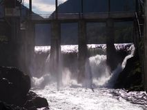 Water boiling in waterfall under old hydropower plant stock video