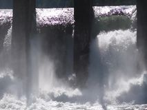 Water boiling in waterfall under old hydropower plant stock footage