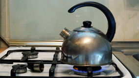 Water boils in a kettle  on a gas stove in the kitchen stock footage