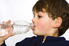 Water bootle boy. Young boy drinking water from a plastic bottle Stock Images