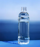 Water bottle. On a blue background Royalty Free Stock Photos