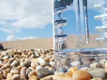 Water bottle. On beach royalty free stock photos