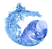 Water bottle. Plastic bottle in water swirl Royalty Free Stock Photography