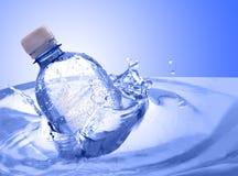 Water bottle. Plastic bottle in water splash Royalty Free Stock Image
