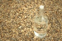 Water in bottle on the background of rocks. Royalty Free Stock Photography