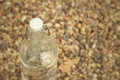 Water in bottle on the background of rocks. Royalty Free Stock Image